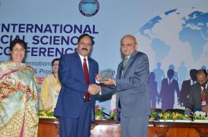 Prof. Dr. Habib Ur Rehman Presenting a Shield to Prof. Dr. Syed Zahoor Hassan